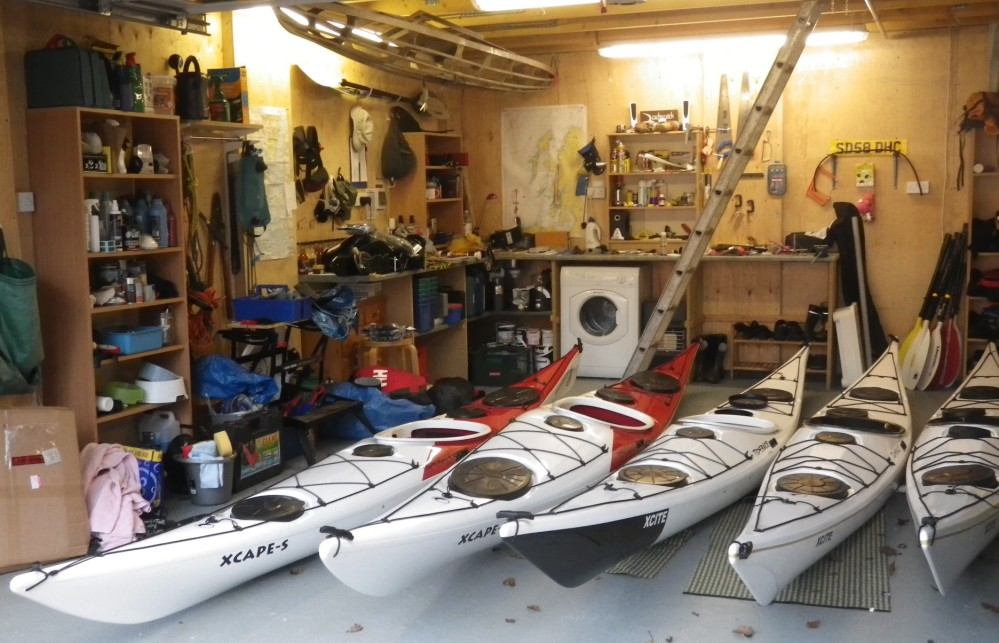Garage full of Tiderace kayaks